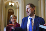 FILE - In this July 21, 2021, file photo Sen. Ron Wyden, D-Ore., chair of the Senate Finance Committee, joined at left by Sen. Elizabeth Warren, D-Mass., talks about their discussions on the national debt with Senate Majority Leader Chuck Schumer, D-N.Y., at the Capitol in Washington. Two senior Democratic senators are introducing legislation that responds to the ravages of COVID-19 in nursing homes. The bill unveiled Tuesday, Aug. 10, by Wyden and Bob Casey of Pennsylvania aims to increase nurse staffing, improve infection control and bolster inspections. (AP Photo/J. Scott Applewhite, File)