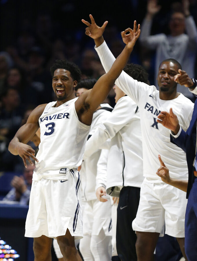 Xavier guard Quentin Goodin (3) reacts to a teammate's 3-point basket during the second half of a first-round NIT college basketball game Wednesday, March 20, 2019, in Cincinnati. (AP Photo/Gary Landers)