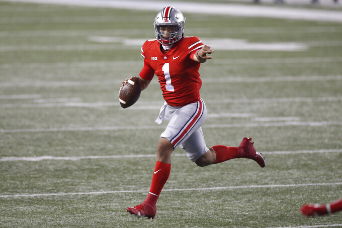Ohio State quarterback Justin Fields looks for an open receiver during the second half of the team's NCAA college football game against Rutgers on Saturday, Nov. 7, 2020, in Columbus, Ohio. Ohio State won 49-27. (AP Photo/Jay LaPrete)