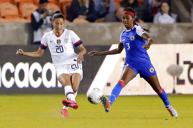 United States forward Christen Press (20) passes the ball in front of Haiti defender Chelsea Surprise (3) during the first half of a women's Olympic qualifying soccer match Tuesday, Jan. 28, 2020, in Houston. (AP Photo/Michael Wyke)