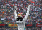 Mercedes driver Lewis Hamilton, of Britain, celebrates after his victory in the Formula One Mexico Grand Prix auto race at the Hermanos Rodriguez racetrack in Mexico City, Sunday, Oct. 27, 2019. (AP Photo/Eduardo Verdugo)