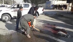 In this image made from video, locals sweep blood at the site of a gun attack on a Japanese aid worker's truck Wednesday, Dec. 4, 2019, Nangarhar province, easter Afghanistan. Japanese physician and aid worker Tetsu Nakamura has died of his wounds after an attack that also killed five Afghans, including the doctor's bodyguards, the driver and a passenger. (AP Photo)