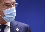 Dutch Prime Minister Mark Rutte wears a protective face mask as he attends a round table meeting at an EU summit in Brussels, Friday, Oct. 16, 2020. European Union leaders meet for the second day of an EU summit, amid the worsening coronavirus pandemic, to discuss topics on foreign policy issues. (Kenzo Tribouillard, Pool via AP)