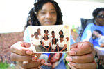 Ella Chism holds a photo of her sisters. Sandra Lockett Huckleberry is seen in the back row on the right end. Huckleberry, 56, was found dead inside her Fair Avenue mobile home in Centreville after church services one Sunday in October 2014; she had been stabbed several times. The life of this kind-spirited woman ended violently, leaving only questions that would torment her family ever since: Who killed her and why? (Emily Enfinger/The Tuscaloosa News via AP)