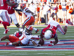 Liberty safety Rion Davis picks up the ball fumbled by Syracuse wide receiver Sean Riley during the first half of an NCAA college football game in Lynchburg, Va. Saturday, Aug. 31, 2019. (AP Photo/Matt Bell)