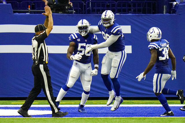 Indianapolis Colts defensive end Justin Houston (50) and defensive tackle DeForest Buckner (99) celebrates a safety against the New York Jets in the second half of an NFL football game in Indianapolis, Sunday, Sept. 27, 2020. (AP Photo/AJ Mast)