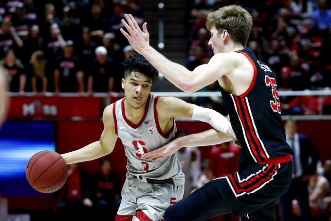 FILE - In this Feb. 6, 2020, file photo, Stanford guard Tyrell Terry (3) drives as Utah center Branden Carlson (35) defends in the first half during an NCAA college basketball game in Salt Lake City.  Terry has declared for the NBA draft. Terry announced his decision Monday, April 6, 2020, to enter the draft without forfeiting his collegiate eligibility. He could still withdraw from consideration before June 3 and return to school. That deadline could be extended because the NBA season is on hold due to the new coronavirus. (AP Photo/Rick Bowmer, File)