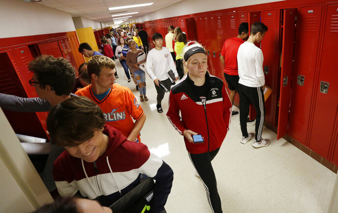 In a Wednesday, September 25, 2019 photo, Oostburg High School students move through the hall during between classes, Wednesday, September 25, 2019, in Oostburg, Wis.  (Gary C. Klein/The Sheboygan Press via AP)