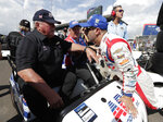 FILE - In this May 19, 2018, file photo, Tony Kanaan, right, of Brazil, talks with car owner AJ Foyt after Kanaan qualified for the Indianapolis 500 auto race at Indianapolis Motor Speedway in Indianapolis. The speedway is closed due to the coronavirus pandemic. (AP Photo/Michael Conroy, File)