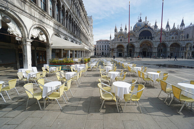 Empty chairs and tables are lined up outside a restaurant in St. Mark's Square in Venice, Italy, Monday, March 9, 2020. Italy took a page from China's playbook Sunday, attempting to lock down 16 million people — more than a quarter of its population — for nearly a month to halt the relentless march of the new coronavirus across Europe. Italian Premier Giuseppe Conte signed a quarantine decree early Sunday for the country's prosperous north. Areas under lockdown include Milan, Italy's financial hub and the main city in Lombardy, and Venice, the main city in the neighboring Veneto region. (Anteo Marinoni/LaPresse via AP)