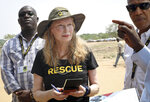 In this photo taken Tuesday, April 2, 2019, human rights activist Mia Farrow takes notes while speaking with staff from the International Rescue Committee while visiting an internally displaced person's camp in the capital Juba, South Sudan. Human rights activist Mia Farrow spoke to The Associated Press as she visited South Sudan again in her new role as envoy for the International Rescue Committee, helping the aid group to promote a global initiative to change the way humanitarian organizations approach malnutrition. (AP Photo/Sam Mednick)