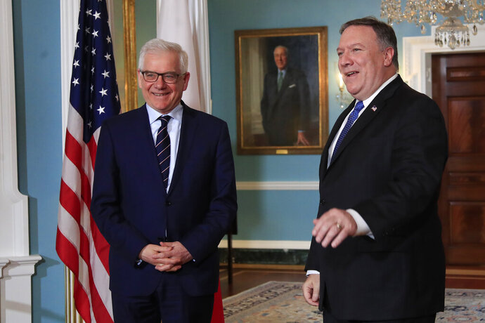 FILE - In this Monday, May 21, 2018 file photo, Secretary of State Mike Pompeo, right, meets with Polish Foreign Minister Jacek Czaputowicz at the State Department in Washington. The Polish government, which is closely aligned with President Donald Trump, has joined forces with the U.S. to co-host an international conference on the Middle East on Wednesday Feb. 12, 2019 and Thursday Feb. 13 in Warsaw, hoping to strengthen its ties with Washington as its seeks greater protection from Russia. The hosts are U.S. Secretary of State Mike Pompeo and Polish Foreign Minister Jacek Czaputowicz. (AP Photo/Manuel Balce Ceneta, File)
