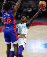 Charlotte Hornets forward Jalen McDaniels (6) is defended by Detroit Pistons center Isaiah Stewart (28) during the first half of an NBA basketball game, Tuesday, May 4, 2021, in Detroit. (AP Photo/Carlos Osorio)