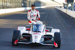 FILE - Marco Andretti poses during the front row photos session for the Indianapolis 500 auto race at Indianapolis Motor Speedway in Indianapolis, in this Monday, Aug. 17, 2020, file photo. Marco Andretti made the decision at the start of this year to step away from full-time racing and essentially end three generations of the most famous family in motorsports competing at the highest level.  (AP Photo/Michael Conroy, File)