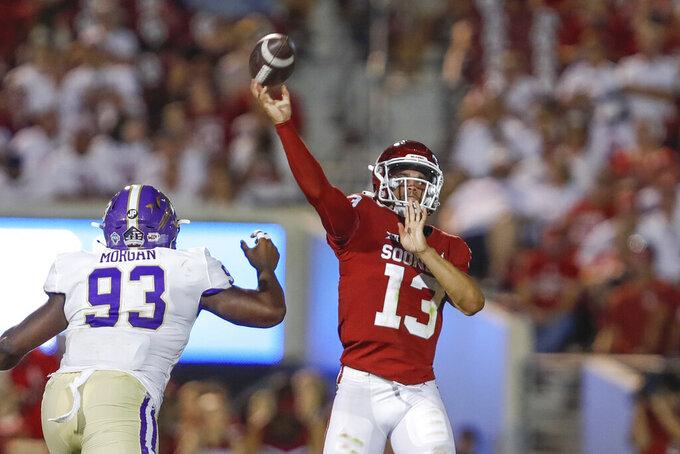 Oklahoma quarterback Caleb Williams (13) throws a pass against Western Carolina during the fourth quarter of an NCAA college football game Saturday, Sept. 11, 2021, in Norman, Okla. Oklahoma won 76-0. (AP Photo/Alonzo Adams)