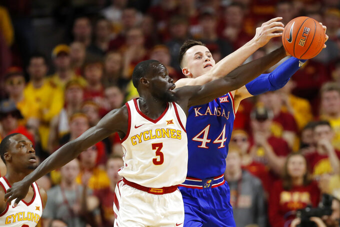 Iowa State guard Marial Shayok (3) fights for the ball with Kansas forward Mitch Lightfoot (44) during the first half of an NCAA college basketball game, Saturday, Jan. 5, 2019, in Ames, Iowa. (AP Photo/Charlie Neibergall)