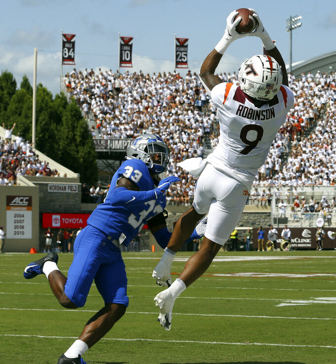 Virginia Tech wide receiver Tayvion Robinson (9) catches a touchdown pass past Middle Tennessee cornerback Decorian Patterson (33) in the first half of an NCAA college football game, Saturday, Sept. 11, 2021, in Blacksburg Va. (AP Photo/Matt Gentry)