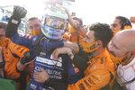Mclaren driver Daniel Ricciardo of Australia celebrates after winning during the Italian Formula One Grand Prix, at Monza racetrack, in Monza, Italy, Sunday, Sept.12, 2021. (Lars Baron/Pool via AP)