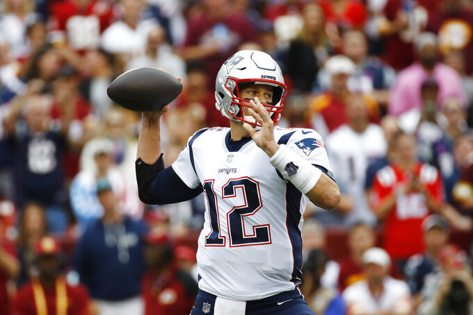 New England Patriots quarterback Tom Brady (12) works in ther pocket against the Washington Redskins during the first half of an NFL football game, Sunday, Oct. 6, 2019, in Landover, Md. (AP Photo/Patrick Semansky)
