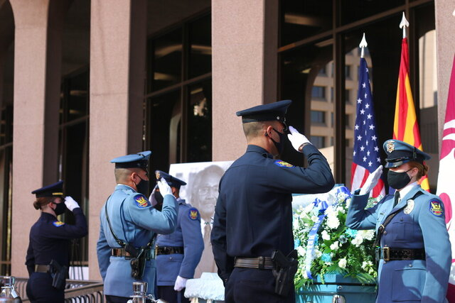 Members of the Phoenix Police Department stand vigil during the open casket viewing of former Phoenix Vice Mayor and city councilman Calvin C. Goode at the Calvin C. Goode Municipal Building in Phoenix, Ariz. on Saturday, Jan. 9, 2021. Goode died on Wednesday, Dec. 23, 2020. He was 93. (AP Photo/Cheyanne Mumphrey)