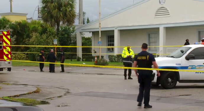 This still image taken from video provided by WPEC CBS 12 News shows emergency responders at the scene of a shooting at the Victory City Church in Riviera Beach, Fla., Saturday, Feb. 1, 2020. Fatalities were caused by gunfire that erupted at a funeral according to authorities.  (WPEC CBS 12 News via AP)
