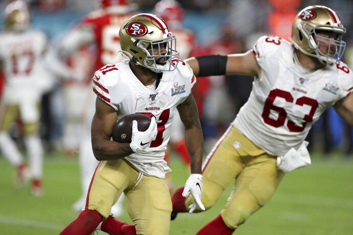 FILE - In this Feb. 2, 2020 file photo, San Francisco 49ers running back Raheem Mostert (31) rushes against the Kansas City Chiefs at Super Bowl 54  in Miami Gardens, Fla. Working out a new contract with the San Francisco 49ers wasn't the only thing Raheem Mostert had to do before deciding whether to play football this season. There was a much more important family matter to deal with as well. (AP Photo/Gregory Payan, File)
