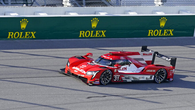 Felipe Nasr, far left, of Brazil, leads during the early laps of the Rolex 24 hour auto race at Daytona International Speedway, Saturday, Jan. 30, 2021, in Daytona Beach, Fla. (AP Photo/John Raoux)