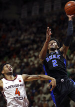 Duke's Cam Reddish (2) scores past Virginia Tech's Nickeil Alexander-Walker (4) during the first half of an NCAA college basketball game in Blacksburg, Va., Tuesday, Feb. 26, 2019. (Matt Gentry/The Roanoke Times via AP)