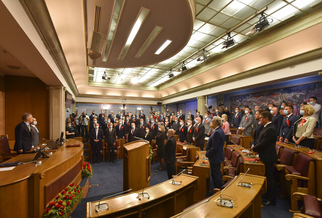 Montenegro's lawmakers take part in the parliament session in Podgorica, Montenegro, Wednesday, Sept. 23, 2020. Montenegro's new parliament has convened for the first time since last month's election with lawmakers from formerly opposition groups set to form a new governing majority and oust from power a party that has ruled the Balkan country for some 30 years. (AP Photo/Risto Bozovic)