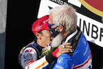 Takuma Sato, of Japan, hugs David Letterman after winning the Indianapolis 500 auto race at Indianapolis Motor Speedway, Sunday, Aug. 23, 2020, in Indianapolis. (AP Photo/Darron Cummings)