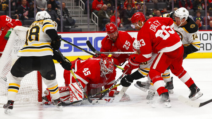 Detroit Red Wings goaltender Jonathan Bernier (45) stops the puck in the third period of an NHL hockey game against the Boston Bruins, Sunday, Feb. 9, 2020, in Detroit. (AP Photo/Paul Sancya)