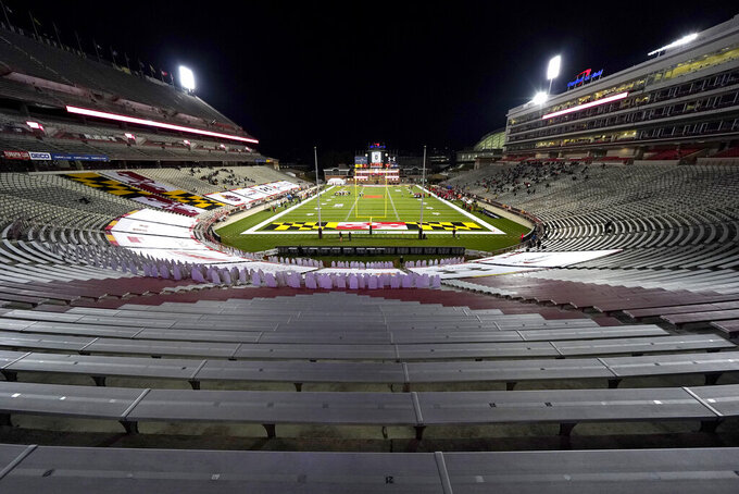 Empty stands are seen during the first half of an NCAA college football game between Maryland and Minnesota, Friday, Oct. 30, 2020, in College Park, Md. (AP Photo/Julio Cortez)