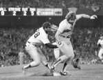 FILE - In this October 1981 file photo, Los Angeles Dodgers' Steve Yeager, right, and New York Yankees first baseman Bob Watson collide during a close play at first base in the fifth inning of a World Series baseball game in New York. Yeager lined a ball off Yankees pitcher Tommy John's glove, who recovered to throw to Watson for the tag. Watson held on the ball and Yeager was out on the play to end the inning. Watson, a two-time All-Star as a player who later became the first African American general manager to win a World Series with the Yankees in 1996, has died. He was 74. (AP Photo, File)