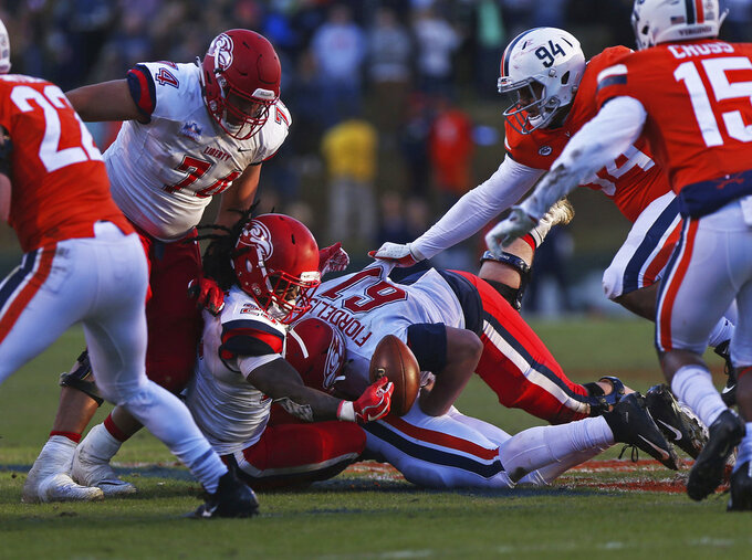 Liberty running back Frankie Hickson (23) fumbles the ball in the first half  of an NCAA college football game against Virginia  Saturday, Nov. 10, 2018, in Charlottesville, Va. (Zack Wajsgras /The Daily Progress via AP)