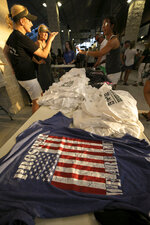 Shirts for sale during the opening of the new Children's Health Stadium at Prosper ISD on Saturday, Aug. 17, 2019 in Prosper, Texas. Democrats are out to show they're serious about flipping Texas in 2020 by holding Thursday's presidential debate in Houston. Republicans are coming off their worst election in Texas in a generation. Fast-changing suburbs are trending more liberal, and Democrats are counting on more left-leaning voters moving in to turn the state blue. But that transformation may not arrive by 2020, and the GOP is closely watching conservative bastions like the booming Dallas suburbs. (AP Photo/Nathan Hunsinger)