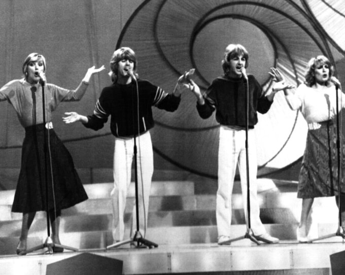 """FILE - In this April 4, 1981 file photo, Buck's Fizz on stage during rehearsals for the Eurovision Sing contest in Dublin, Ireland. The band won the contest with their song """"Making Your Mind Up."""" (AP Photo/Bob Dear, File)"""