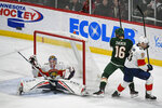 Florida Panthers goalie Sergei Bobrovsky, left, stops a shot by Minnesota Wild winger Jason Zucker (16) as Panthers defenseman Riley Stillman pushes Zucker past the goal during the first period of an NHL hockey game Monday, Jan. 20, 2020, in St. Paul, Minn. (AP Photo/Craig Lassig)