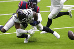 Jacksonville Jaguars running back James Robinson (30) fumbles as he is hit by Houston Texans linebacker Tyrell Adams (50) during the second half of an NFL football game Sunday, Oct. 11, 2020, in Houston. (AP Photo/Michael Wyke)