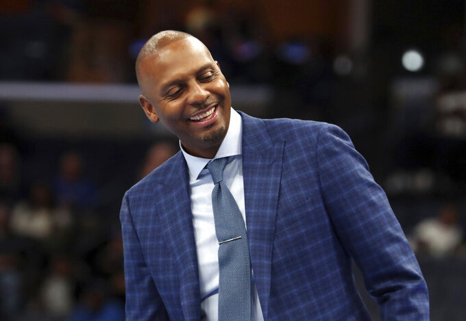 FILE - In this Nov. 9, 2019, file photo, Memphis head coach Penny Hardaway laughs from the bench during an NCAA college basketball game against University of Illinois-Chicago in Memphis, Tenn. Hardaway has agreed to a five-year extension worth $12.2 million with Memphis keeping the third-year men's basketball coach under contract through April 2026. Memphis announced the extension Monday, Dec. 21, 2020. (AP Photo/Karen Pulfer Focht, File)