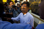 Myanmar police Capt. Moe Yan Naing, center, talks to journalists after his release from Insein prison in Yangon, Myanmar Friday, Feb. 1, 2019. The former police officer was sentenced to a year in jail for violating the Police Disciplinary Act after he testified during the trial of two Reuters journalists that he was ordered to help entrap the two who were accused of possessing state secrets. (AP Photo/Thein Zaw)