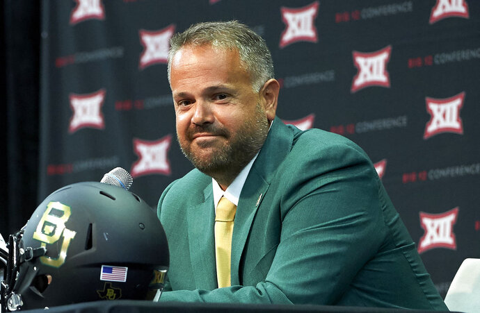 FILE - In this July 17, 2018, file photo, Baylor head coach Matt Rhule speaks during the NCAA college football Big 12 media days, in Frisco, Texas. At 43, Baylor coach Rhule is far removed from a playing career. That doesn't mean he won't run the gauntlet with his guys to prove a point. When Rhule was helping turn around the program at Temple, he already had many of his players outfitted with XTECH shoulder pads, a revolutionary protective device that is gaining traction on all levels of football.