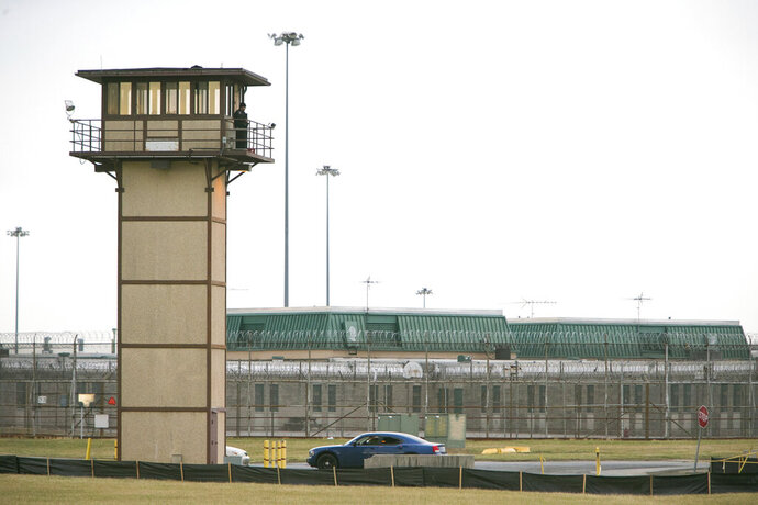 FILE - In this Feb. 1, 2017, file photo, a prison guard stands at one of the towers at James T. Vaughn Correctional Center in Smyrna, Del..  Three convicted killers already serving life terms were sentenced Friday, Sept. 13, 2019 for their roles in a deadly riot at Delaware's maximum-security prison, bringing a close to a lengthy, costly and mostly failed prosecution. The self-proclaimed mastermind of the February 2017 riot, Dwayne Staats, received two life terms for the murder of Steven Floyd, a guard at James T. Vaughn Correctional Center. (Suchat Pederson/The News Journal via AP, File)