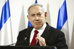 Israeli Prime Minister Benjamin Netanyahu, speaks during a press conference following the killing of a senior Islamic Jihad commander in Gaza by Israel, in Tel Aviv, Israel, Tuesday, Nov. 12, 2019. (AP Photo/Oded Balilty)