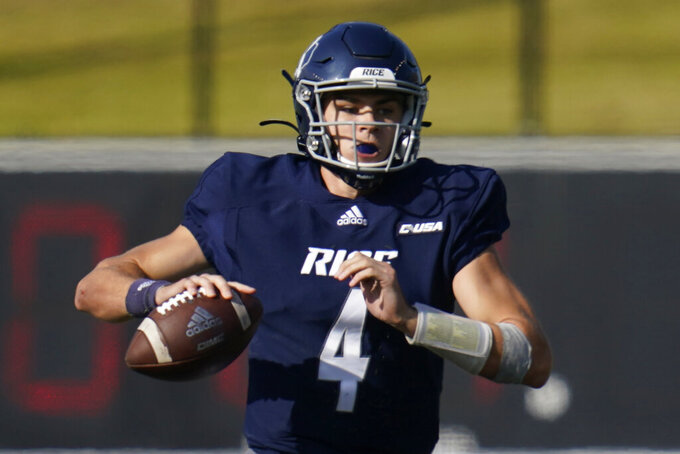 Rice University quarterback Mike Collins (4) looks to pass during an NCAA football game against Middle Tennessee in Houston, on Saturday, Oct. 24, 2020. Rice and No. 15 Marshall meet on Saturday, Dec. 5 in a game that was postponed from Oct. 3. (AP Photo/Matt Patterson)