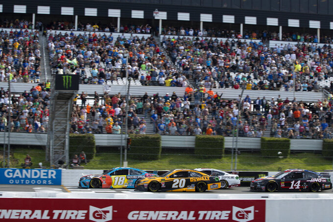 Kyle Busch (18) leads Erik Jones (20) on a restart during a NASCAR Cup Series auto race at Pocono Raceway, Sunday, June 2, 2019, in Long Pond, Pa. (AP Photo/Matt Slocum)