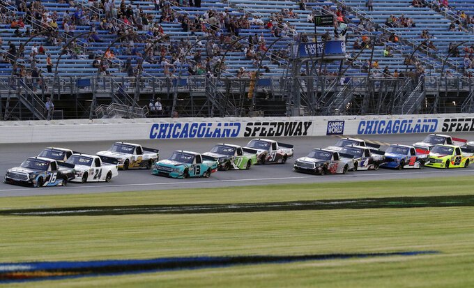 Drivers start a NASCAR Truck Series auto race at Chicagoland Speedway in Joliet, Ill., Friday, June 28, 2019. (AP Photo/Nam Y. Huh)