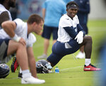 CORRECTS TO JUNE 10, 2021, NOT MAY 27, 2021, AS ORIGINALLY SENT - Tennessee Titans wide receiver Julio Jones, right, stretches during NFL football practice Thursday, June 10, 2021, in Nashville, Tenn. (George Walker IV/Pool Photo via AP)
