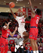 Houston guard Dejon Jarreau (13) shoots between New Jersey Institute of Technology guard Diandre Wilson (15) and forward Abdul Lewis (0) during the first half of an NCAA college basketball game Saturday, Dec. 29, 2018, in Houston. (AP Photo/Michael Wyke)