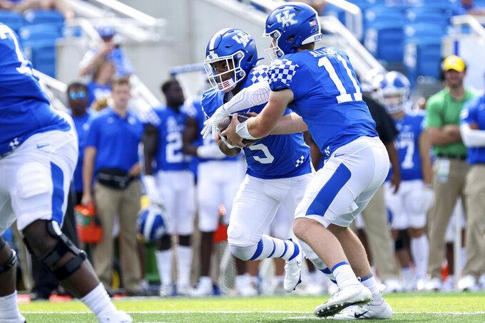 Kentucky quarterback Beau Allen (11) hands the ball off to Michael Drennen II (5) during the second half of an NCAA college football game against Louisiana-Monroe in Lexington, Ky., Saturday, Sept. 4, 2021. (AP Photo/Michael Clubb)