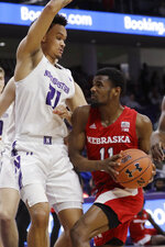 Nebraska guard Dachon Burke Jr., right, drives against Northwestern forward A.J. Turner during the first half of an NCAA college basketball game in Evanston, Ill., Saturday, Jan. 11, 2020. (AP Photo/Nam Y. Huh)
